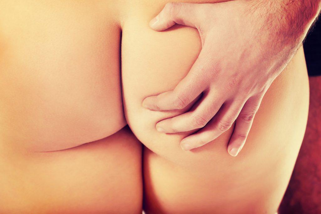 man grabbing woman's butt