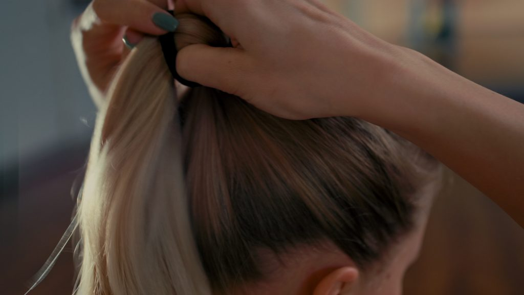 woman fixing her ponytail readying for quarantine sex