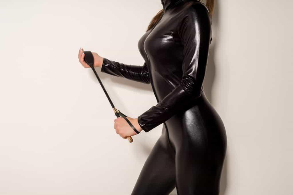female dominatrix with crop kinky sexual fantasies