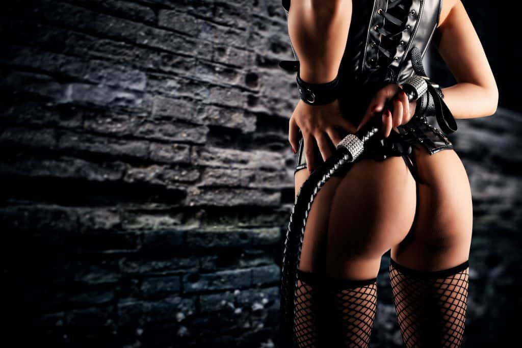 female dominatrix with whip kinky sexual fantasies